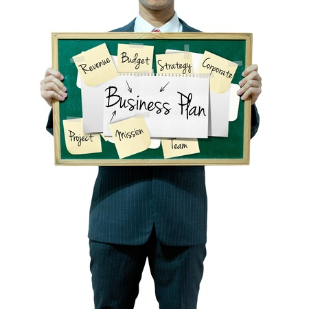 stakeholders: Business man holding board on the background, Business Plan concept