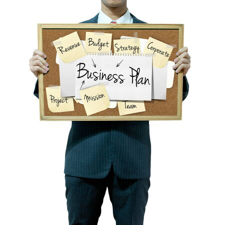 businessplan: Business man holding board on the background, Business Plan concept