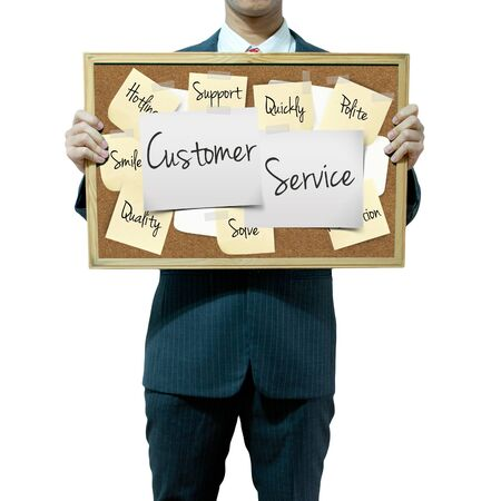 corkboard: Business man holding board on the background, Customer Service concept Stock Photo