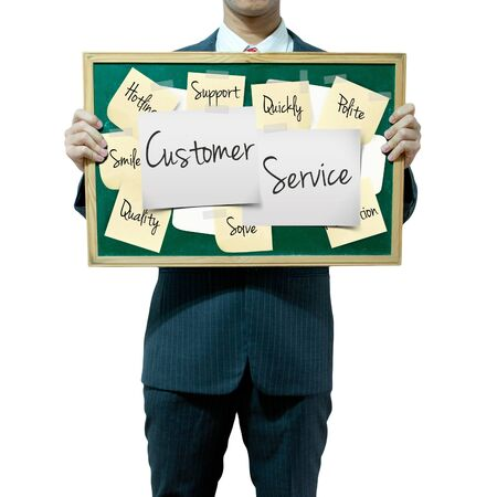 restructuring: Business man holding board on the background, Customer Service concept Stock Photo