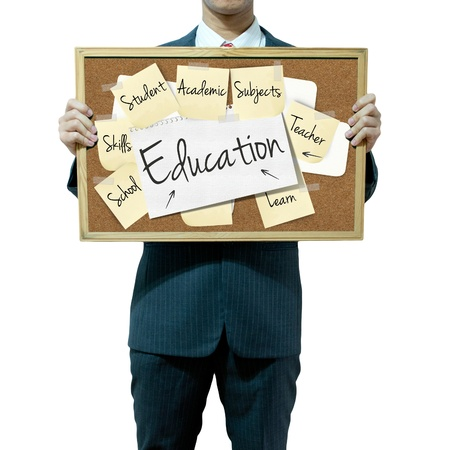 masters degree: Business man holding board on the background, Education concept Stock Photo