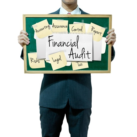 seeks: Business man holding board on the background, Financial Audit concept