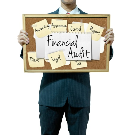 provide: Business man holding board on the background, Financial Audit concept