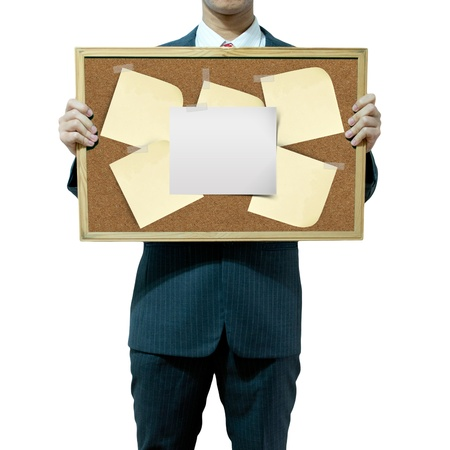 Business man holding cork board on the background Stock Photo - 15559799