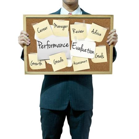 evaluacion: Hombre de negocios la celebración junta en el fondo, el concepto de Evaluación del Desempeño