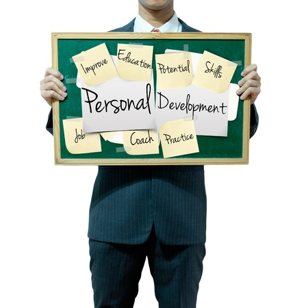 self development: Business man holding board on the background, Personal Development concept Stock Photo