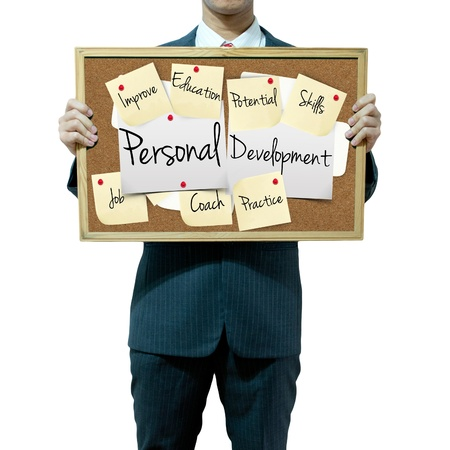 assessment: Business man holding board on the background, Personal Development concept Stock Photo