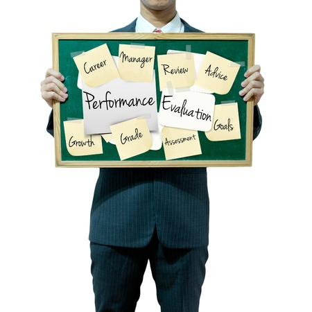 reviews: Business man holding board on the background, Performance Evaluation concept