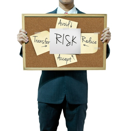 avoid: Business man holding board on the background, risk management