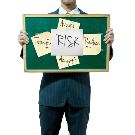 Business man holding board on the background, risk management Stock Photo - 15559795