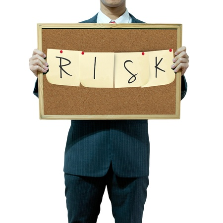 Business man holding board on the background, RISK photo