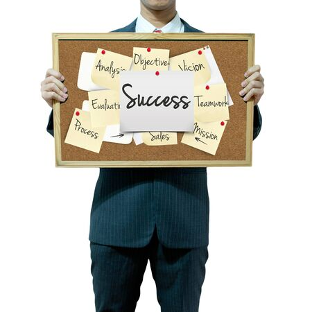complete solution: Business man holding board on the background, Success concept Stock Photo