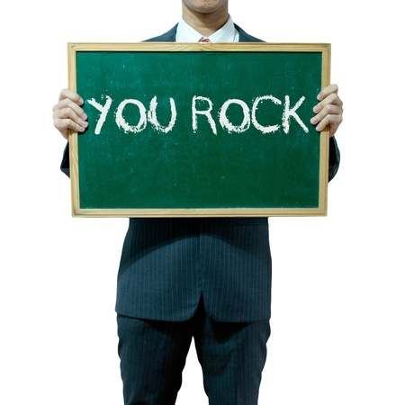well done: Business man holding board on the background, compliments Stock Photo