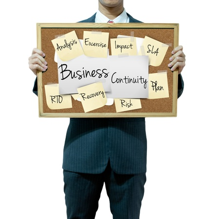 disaster recovery: Business man holding board on the background, Business continuity
