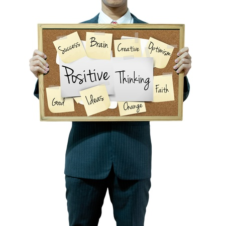 clair: Business man holding board on the background, Positive Thinking Stock Photo