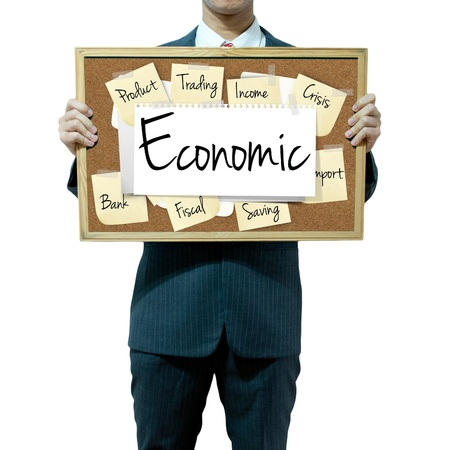 causes: Business man holding board on the background, Economic