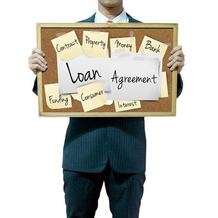 loans: Business man holding board on the background, Loan Agreement Stock Photo