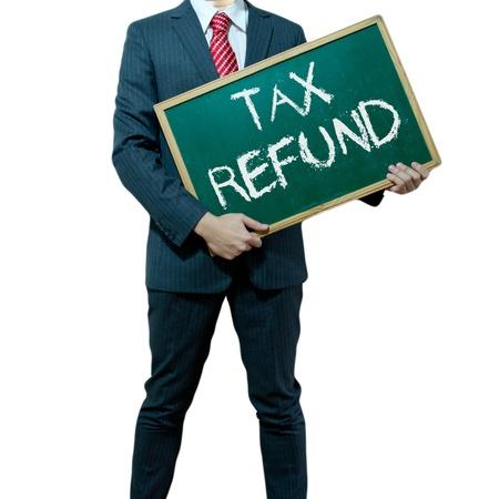 retour: Zakenman die bord op de achtergrond, Tax Refund Stockfoto