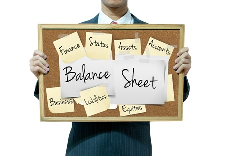 balancesheet: Business man holding board on the background, Balance Sheet
