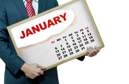 Business man holding black board - calendar 2013 Stock Photo - 17049242