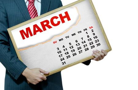 Business man holding black board - calendar 2013 Stock Photo - 17049227