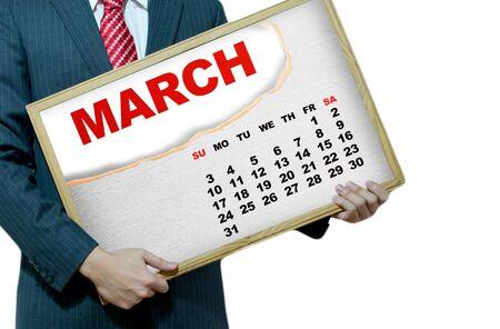 Business man holding black board - calendar 2013 Stock Photo - 17049227