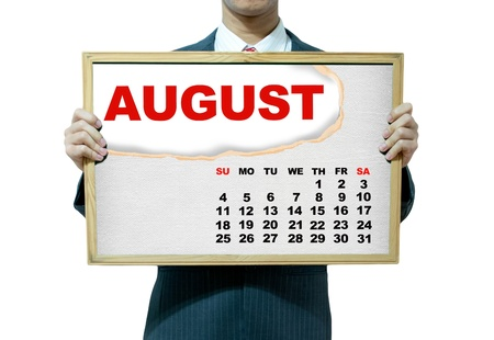 Business man holding board on the background, 2013 calendar photo