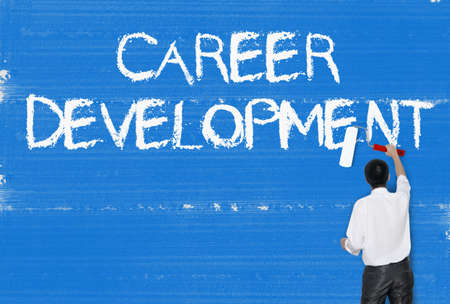 career management: Man painting word on cement texture wall background, Career concept