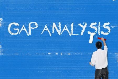 gap: Man painting word on cement texture wall background, Gap analysis