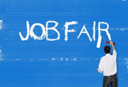 job advertisement: Man painting word on cement texture wall background, Career concept