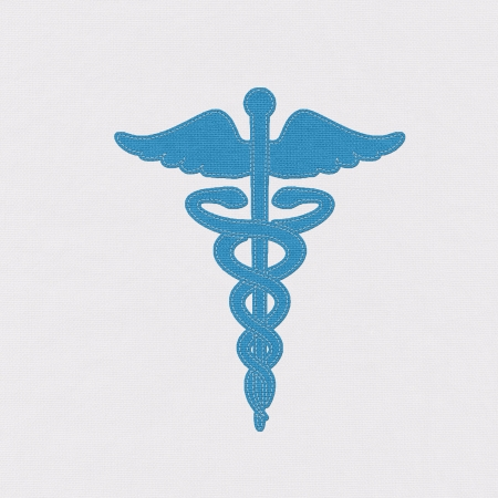 Caduceus medical symbol as a health care and medicine icon with snakes crawling on a pole with wings sign in stitch style photo