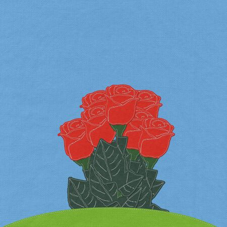 Red rose on green grass field with stitch style fabric background