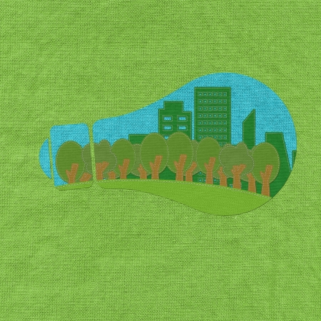 ECO concept inside bulb with stitch style on fabric background photo