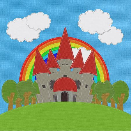 Fairy-tale castle on a green field with stitch style on fabric background photo