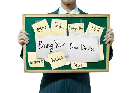 bring: Business man holding board on the background, Bring your own device Stock Photo