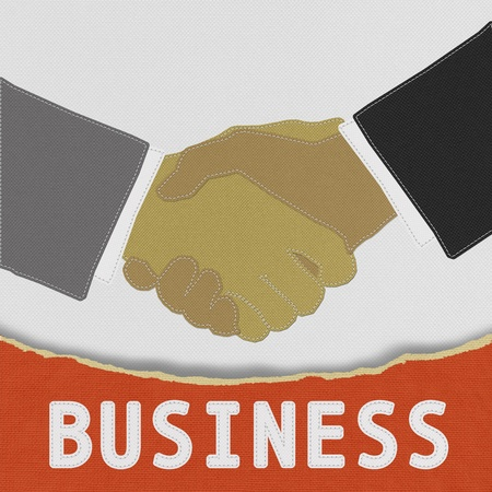 Businessmen shaking hands with stitch style on fabric background photo