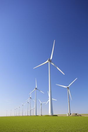 Windmills in Holland producing clean energy to help against global warming  Stock Photo
