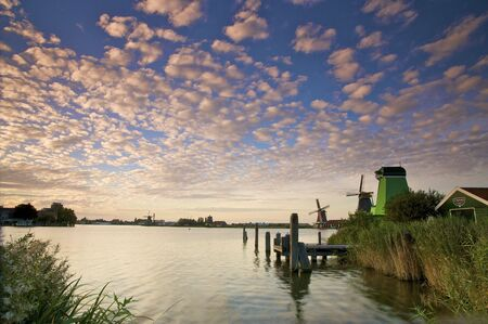A colorful sunset in Holland with windmills and canals photo