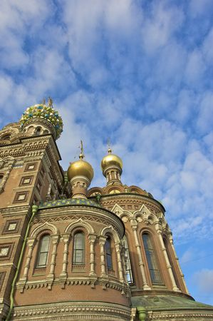 The Church of the Savior on Spilled Blood, St. Petersburg, Russia with a bright blue sky and clouds photo