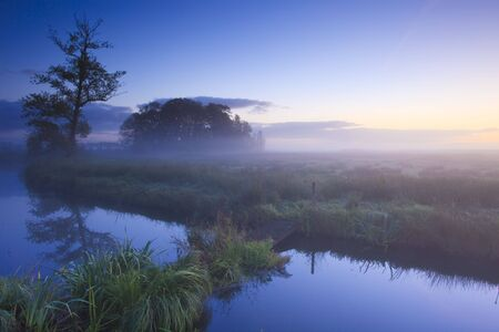 A landscape with fog and a sunrise in the Netherlands Stock Photo - 5688223