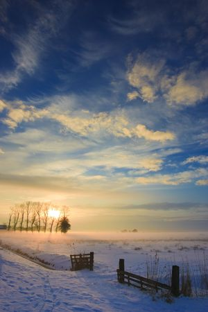 sunset landscape in winter with snow in Holland Stock Photo