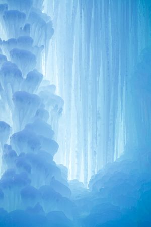 iceberg: A frozen waterfall with ice in a blue and white color in winter Stock Photo