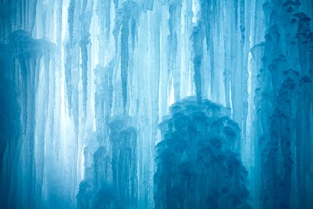 A frozen waterfall with ice in a blue and white color in winter photo