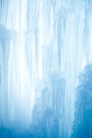 A frozen waterfall with ice in a blue and white color in winter Stock Photo