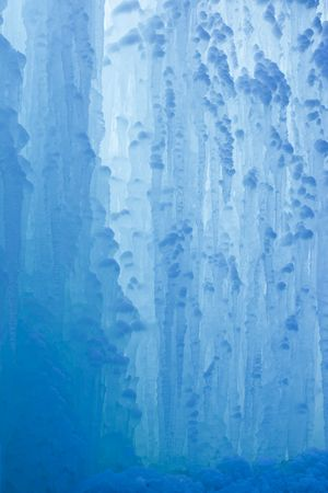 A frozen waterfall with ice in a blue and white color in winter Stock Photo - 5918804
