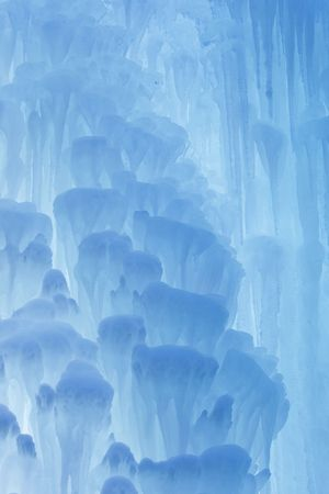 A frozen waterfall with ice in a blue and white color in winter Stock Photo - 5918801