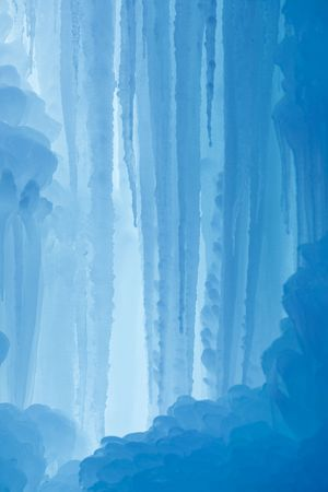 A frozen waterfall with ice in a blue and white color in winter Standard-Bild - 5918798