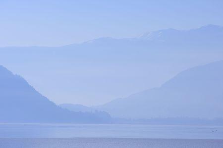 Alps in Austria in a blue evening fog photo