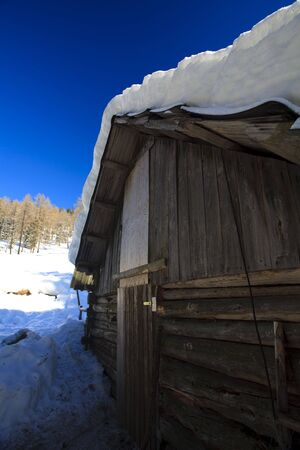 Old barn in winter in the mountains on a sunny day Stock Photo - 5932795