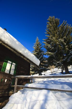 Old barn in winter in the mountains on a sunny day Stock Photo - 5932796